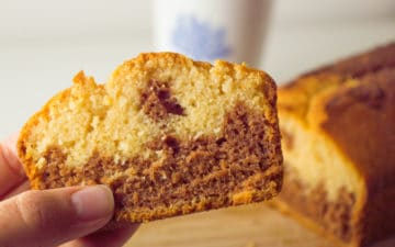 Holding a slice of the low fodmap marble cake, lookink light and fluffy
