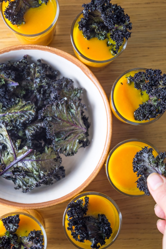 This Roasted pumpkin and carrot soup shooters with crispy kale chips recipe is the perfect thanksgiving appetizer